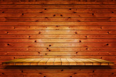 Empty wooden shelf on old wood wall background. Empty wooden shelf on wood wall background. For display or montage your products stock image