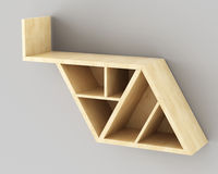 Empty wooden shelf with triangular shapes hanging on the wall Stock Photos
