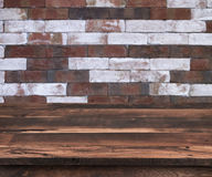 Empty wooden shelf with vintage brick wall pattern as background stock images