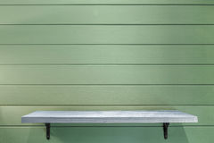 Empty wooden shelf on vintage plank wallpaper Stock Photos