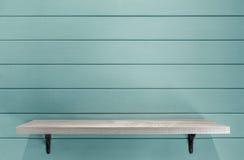Empty wooden shelf on vintage plank wallpaper Royalty Free Stock Photos