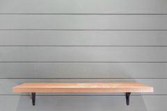 Empty wooden shelf on vintage plank wallpaper Stock Photo