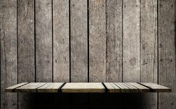 Empty wooden shelf on wooden wall for display Stock Images