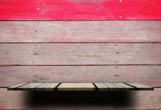 Empty wooden shelf with wooden wall red stripe Royalty Free Stock Photography