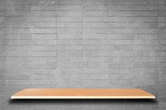 Empty wooden shelves and brick wall background. For product display Stock Photography