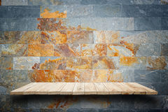 Empty wooden shelves and stone wall background. For product disp Stock Photo