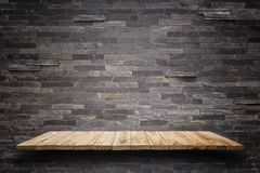 Empty wooden shelves and stone wall background. For product disp. Empty top wooden shelves and stone wall background. For product display Royalty Free Stock Photos