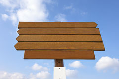 Empty wooden sign on blue sky Royalty Free Stock Photo