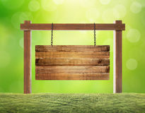 Empty wooden sign hanging Stock Images