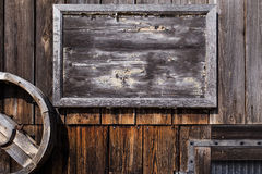 Empty wooden sign on a wall Royalty Free Stock Photos