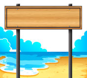 An empty wooden signboard at the beach Stock Photo
