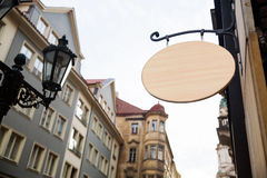 Empty wooden signboard on a european street. Architectural detail Stock Photo