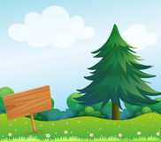An empty wooden signboard at the garden stock illustration
