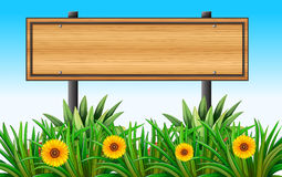 An empty wooden signboard at the garden Royalty Free Stock Image