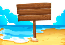 An empty wooden signboard at the sea Royalty Free Stock Image