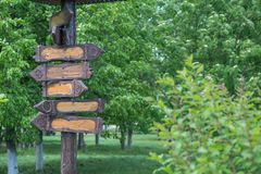Wooden signpost with arrows. Empty wooden signpost with arrows stock photos