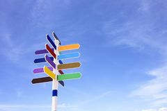 Empty on wooden signpost. Empty wooden signpost with colorful arrows on blue sky background Royalty Free Stock Photography