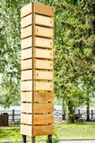 Empty wooden signpost with seven arrows royalty free stock photography