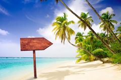 Empty wooden signpost at tropical beach. Wooden signpost at tropical beach stock photography