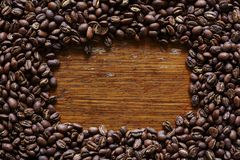 Empty wooden space in dark roasted coffee beans Royalty Free Stock Images