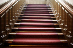 Empty wooden staircase with red carpet Stock Photography
