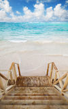 Empty wooden stairs goes down to ocean coast Stock Photo