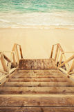 Empty wooden stairs goes down to the sea Royalty Free Stock Image
