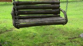 Empty wooden swing chain stock video