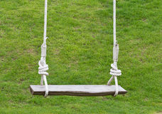 Empty wooden swing Royalty Free Stock Image