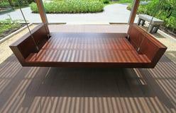 Empty wooden swing Stock Image
