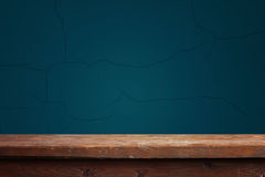 Empty wooden table against a blue wall Stock Images