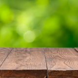 Empty wooden table against green background Stock Images