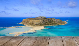 Empty wooden table with amazing view over Balos Lagoon and Gramvousa island on Crete, Greece Royalty Free Stock Image