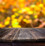 Table with autumn background Stock Image