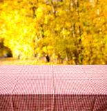 Table with autumn background Royalty Free Stock Photography