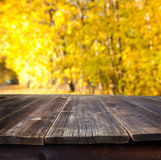 Table with autumn background Stock Photo