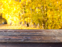 Table with autumn background Royalty Free Stock Photos