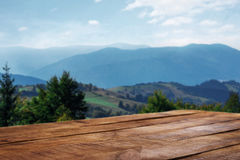Empty wooden table in the background of the mountains Royalty Free Stock Photography