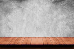 Empty wooden table with bare concrete wall background. For display or montage your products stock images