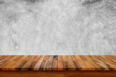 Empty wooden table with bare concrete wall background. For display or montage your products stock image