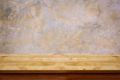 Empty wooden table with bare concrete wall background. For display or montage your products royalty free stock image