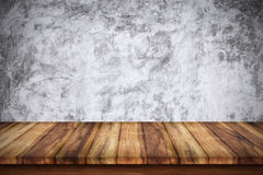 Empty wooden table with bare concrete wall background. For display or montage your products stock photography