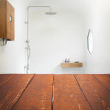 Empty wooden table with bathroom. Empty wooden table for advertising Stock Photo