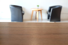 Empty wooden table with blur background in coffee cafe Royalty Free Stock Photography