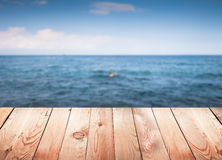 Empty wooden table with blur sea Royalty Free Stock Images