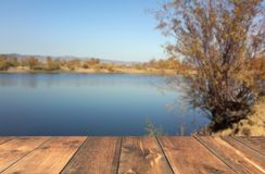 Empty wooden table blured lake Royalty Free Stock Photography
