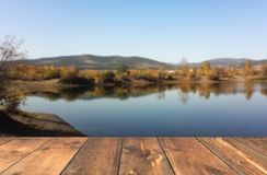 Empty wooden table blured lake Royalty Free Stock Image