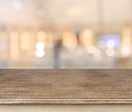Empty wooden table and blurred abstract background Stock Photos