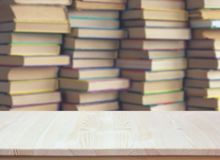 Empty wooden table on blurred background of books. empty Desk. Empty wooden table on blurred background of books. library, education. empty Desk stock photos