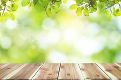 Empty wooden table with blurred city park on background. royalty free stock image